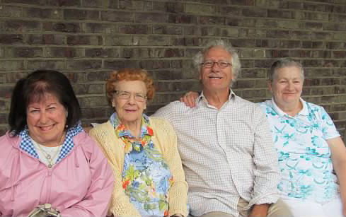 This image shows three Methodist Towers Senior Living Community residents who are friends, sitting on one of our outside benches.